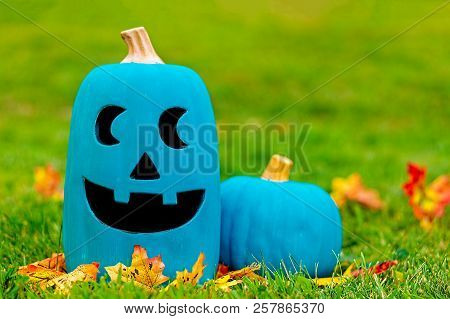 Two Teal Pumpkins Outside. Symbol Of Alternative Non-food Treats For Children With Food Allergies. T