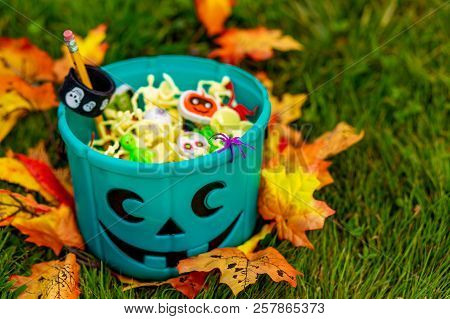 Halloween Teal Basket Full Of Non-food Treats. Halloween Party Favors For Kids With Food Allergy. Te