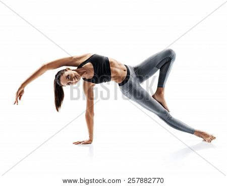 Young Attractive Girl Practicing Yoga Isolated On White Background. Concept Of Healthy Life And Natu