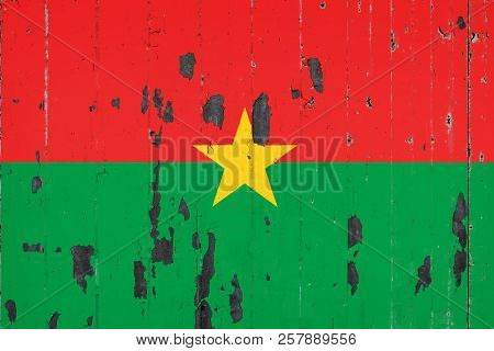 National Flag Of Burkino Faso On The Background Of An Old Mettale Covered With Peeling Paint