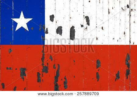 National Flag Of Chile On The Background Of An Old Mettale Covered With Peeling Paint