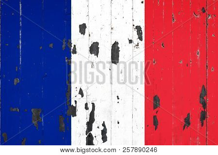 National Flag Of France On The Background Of An Old Mettale Covered With Peeling Paint