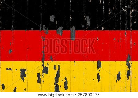 National Flag Of Germany On The Background Of An Old Mettale Covered With Peeling Paint
