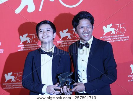 Aditya Ahmad (R) poses with the Orizzonti Award for Best Short Film Award for Kado at the Winners Photocall during the 75th Venice Film Festival on September 8, 2018 in Venice, Italy.