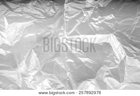 Crumpled Transparent Plastic  Surface In Black And White. Abstract Background And Texture For Design