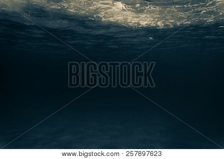 The Underwater Ocean With The Rays Of The Sun. Sandy Bottom.