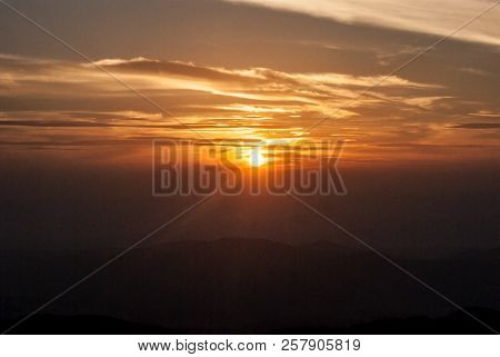 Sunset With Colorful Sky, Sun And Few Clouds From Klak Hill In Mala Fatra Mountains In Slovakia