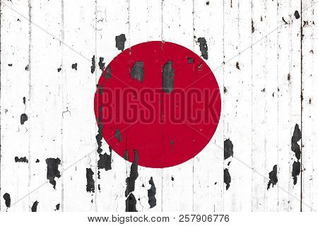 National Flag Of Japan On The Background Of An Old Mettale Covered With Peeling Paint