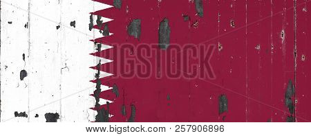 National Flag Of Qatar  On The Background Of An Old Mettale Covered With Peeling Paint