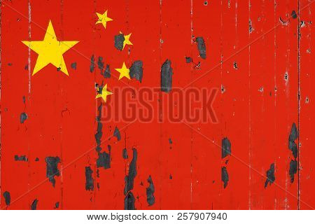 National Flag Of China On The Background Of An Old Mettale Covered With Peeling Paint