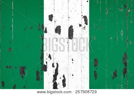 National Flag Of Nigeria On The Background Of An Old Mettale Covered With Peeling Paint