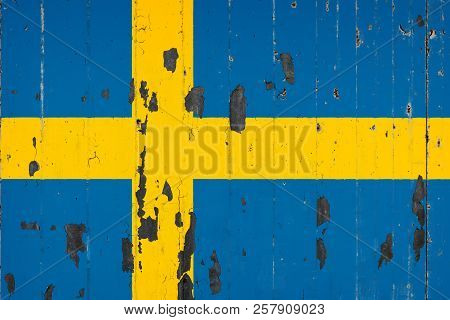 National Flag Of Sweden On The Background Of An Old Mettale Covered With Peeling Paint