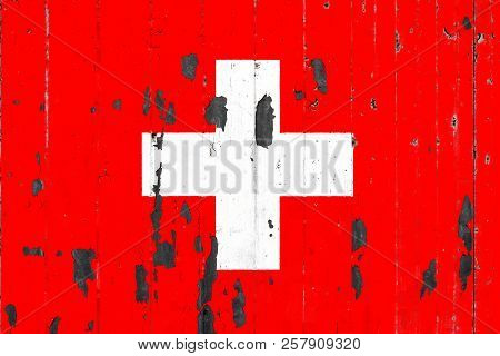 National Flag Of Switzerland On The Background Of An Old Mettale Covered With Peeling Paint