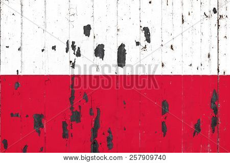 National Flag Of Poland On The Background Of An Old Mettale Covered With Peeling Paint