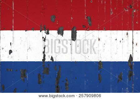 National Flag Of Netherlands On The Background Of An Old Mettale Covered With Peeling Paint