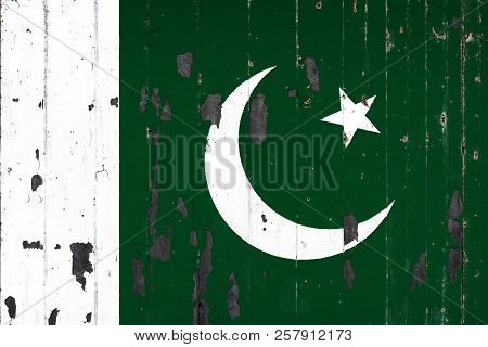 National Flag Of Pakistan On The Background Of An Old Mettale Covered With Peeling Paint