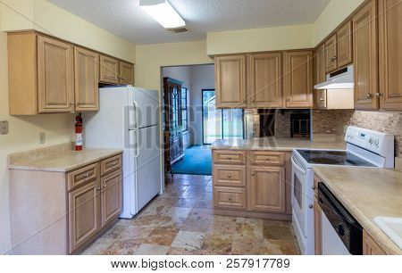 Dated 1980s kitchen interior in need of remodel.