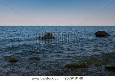 Seascape. Large Rocks In The Sea. Beautiful Sea Shore With Large Stones In The Sea. Sunset Sea.