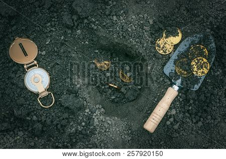 Coins, Shovel And Compass. Coins Searching. Treasure Hunting Concept. In Search Of A Lost Treasure.