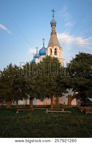 Church Of Peter And Paul In The Village Of Vetvenik Among The Gardenat Sunset.