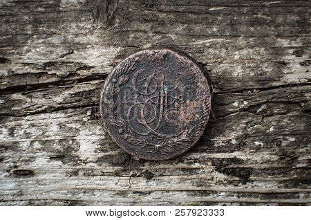 Ancient 5 Kopeks Coin Of Russian Empire On Wooden Table Background.