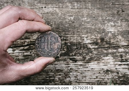 Man Hand Holding An Ancient 5 Kopeks Coin Of Russian Empire On Wooden Table Background With Copy Spa