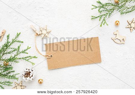 Christmas Gift Tag With New Year's Decorations & Coniferous Branch On White.