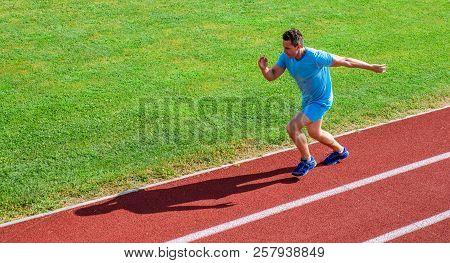 Sprinter training at stadium track. Runner captured in midair. Short distance running challenge. Boost speed. Athlete run track grass background. Run into shape. Running challenge for beginners poster