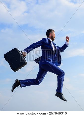Businessman formal suit make effort to succeed. Supernatural power. Success in business demands supernatural efforts from entrepreneur personality. Businessman with briefcase jump high motion forward poster