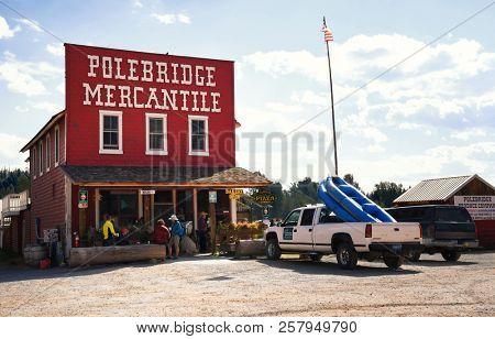 POLEBRIDGE, MONTANA, USA - September 9, 2018: Tourists gather on the front porch of the historical landmark Polebridge Mercantile