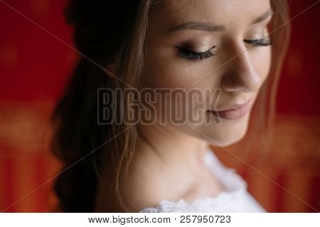Close Up Portrait Of Young Pretty Bride Woman With Nude Make Up In White Wedding Dress Standing Near
