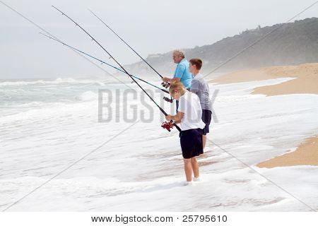 grandpa and grandsons fishing on beach