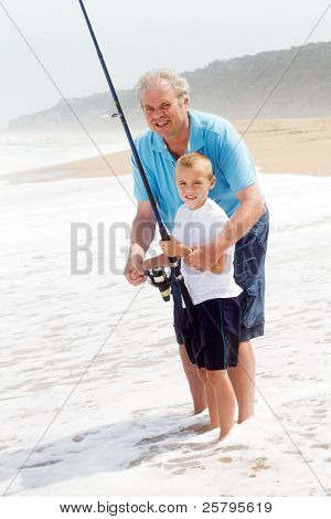 grandpa teaching grandson fishing on the beach