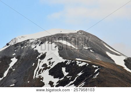 Summit Rock In The Scotland Highlands With Snow