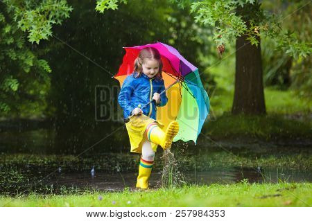 Little Girl With Umbrella In The Rain