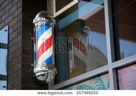 barber pole. red white and blue barber pole. hair salon. barber shop