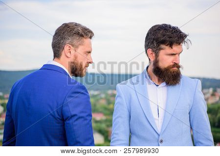 Sure Sign You Should Not Trust Business Partner. Men Formal Suits Stand Confidently Blue Sky Backgro