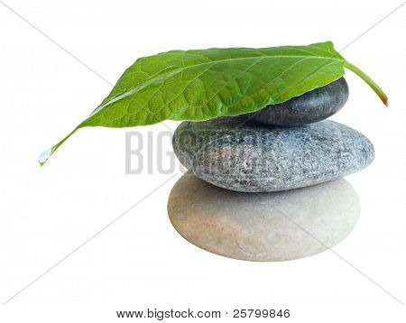 Stones with leaf and water drop isolated on white background.