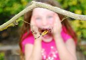 Frightened Girl Screaming After Seeing Huge Spider poster