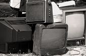 Obsolete or broken television stacked for disposal poster