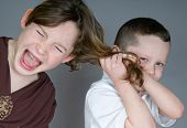 Bully boy pulling girl's hair poster