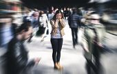 Panic attack in public place. Woman having panic disorder in city. Psychology, solitude, fear or mental health problems concept. Depressed sad person surrounded by people walking in busy street. poster