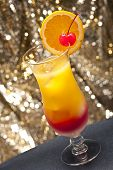Tequila sunrise Cocktail in front of different colored backgrounds poster