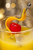 Harvey Wallbanger Cocktail in front of different colored backgrounds poster