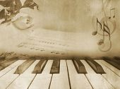 Grunge musical background - piano keys, sheet music and rose - vintage design in sepia tone poster