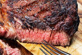 Medium Roast Rib-eye Steak On Wooden Background