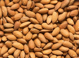 Top View Of Heap Of Almonds As Textured Background