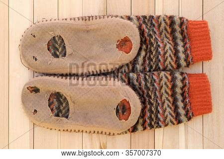 Textile Slippers With Holes On The Soles. Homemade Soft Cozy And Warm Home Slippers Worn. Old Home W