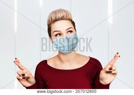 Portrait Young Woman With Cross Fingers. Wearing Protective Face Mask Prevent Virus Infection
