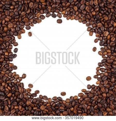 Close-up And Top View Of Roasted Thai Coffee Beans And Empty Area For Copy Space On White Background